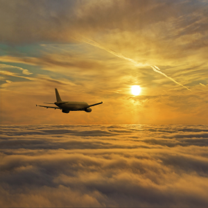 plane above clouds 300