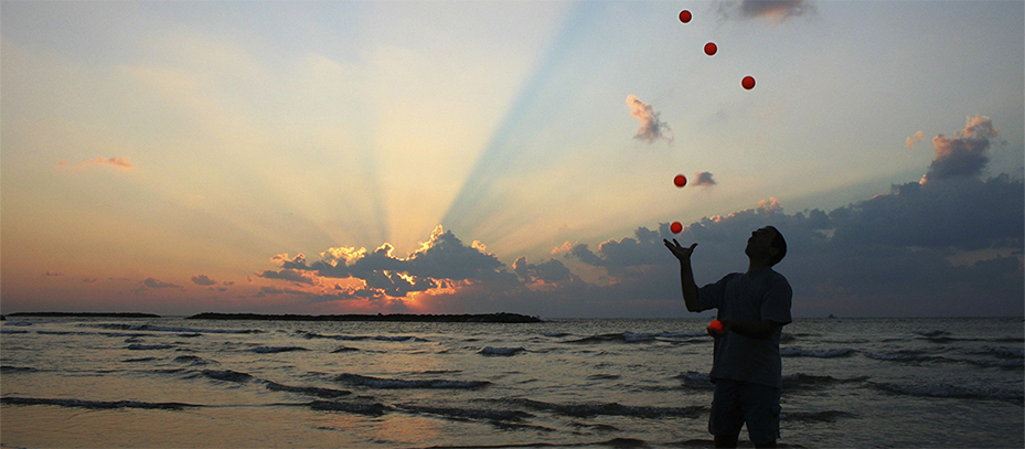 juggling on beach cropped