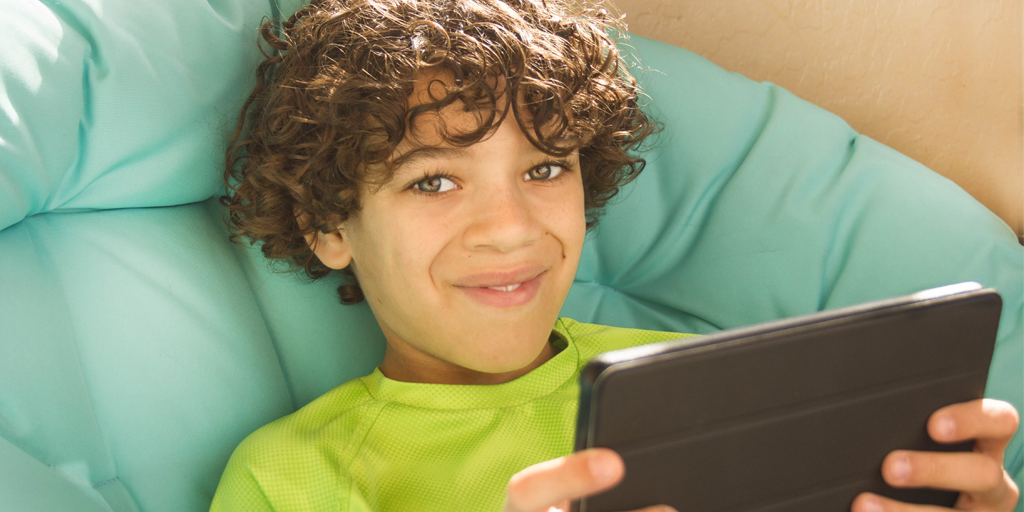 boy-with-ipad-smiling